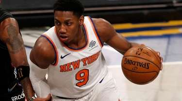 RJ Barrett #9 of the Knicks controls the