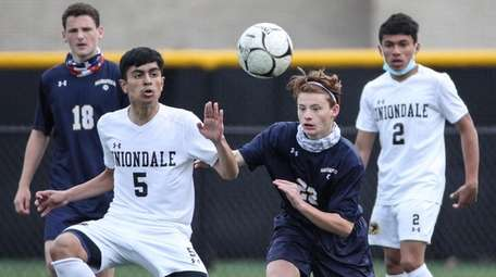 Uniondale's Daniel Mejia (5) goes for the ball