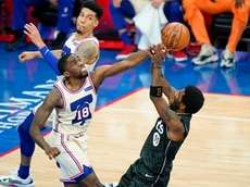 Nets' Kyrie Irving, right, tries to get a