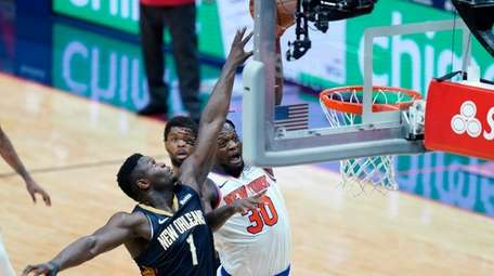 Knicks forward Julius Randle (30) goes to the