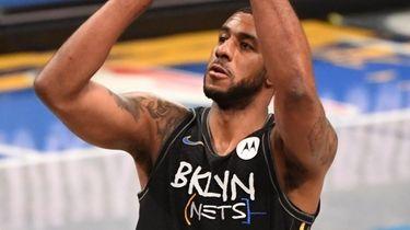 Nets center LaMarcus Aldridge shoots a free throw