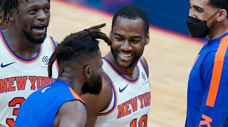 Knicks guard Alec Burks celebrates his three-point basket
