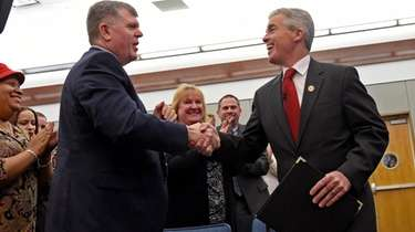 Suffolk County Executive Steve Bellone, right, and Town