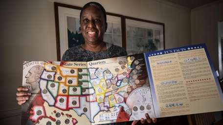 Jennifer Scott holds her state quarters collection, which