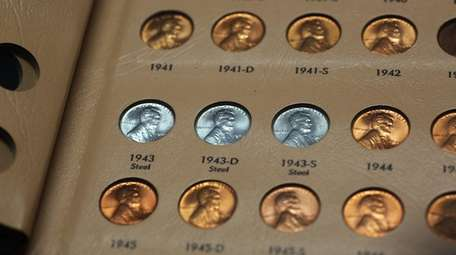 Dr. David Menchell's penny collection is sorted by
