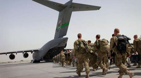 U.S. soldiers walk to get in to a
