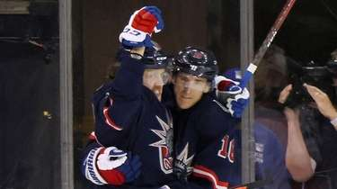 Rangers' Artemi Panarin, left, celebrates his goal in