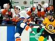 Islanders center Casey Cizikas, left, falls into the