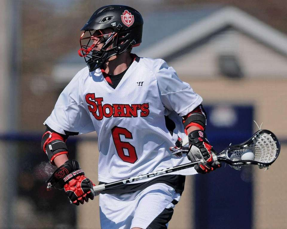St. John's University's Kieran McArdle carries behind the