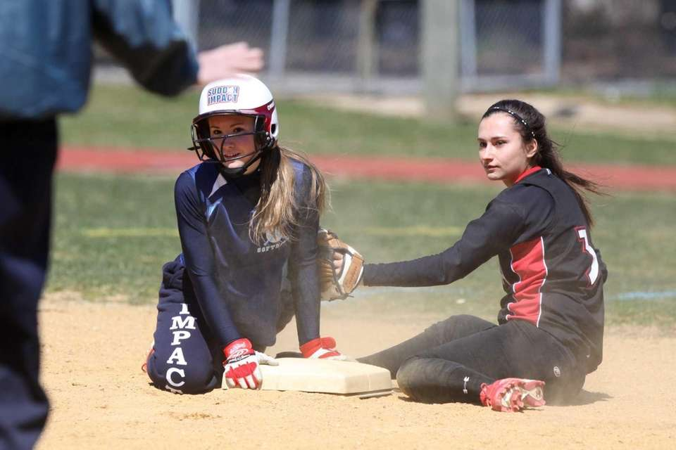 South Side's Katlyn Benincasa, left, is safe from