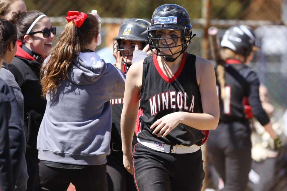 Mineola's Valerie Fischer, right, celebrates runs scored agains
