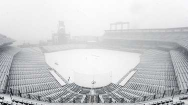 Coors Field is blanketed with snow before a