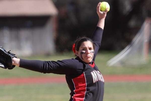 Mineola's Emily Skupp pitches against South Side during