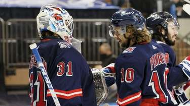 Igor Shesterkin #31 and Artemi Panarin #10 of