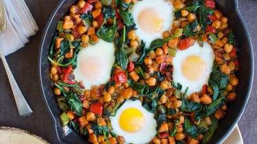 Eggs baked in chickpeas, corn, sweet potato and