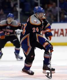 Islanders center Brad Boyes brings the puck