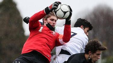 Harborfields goalkeeper Ryan Steel makes the save during