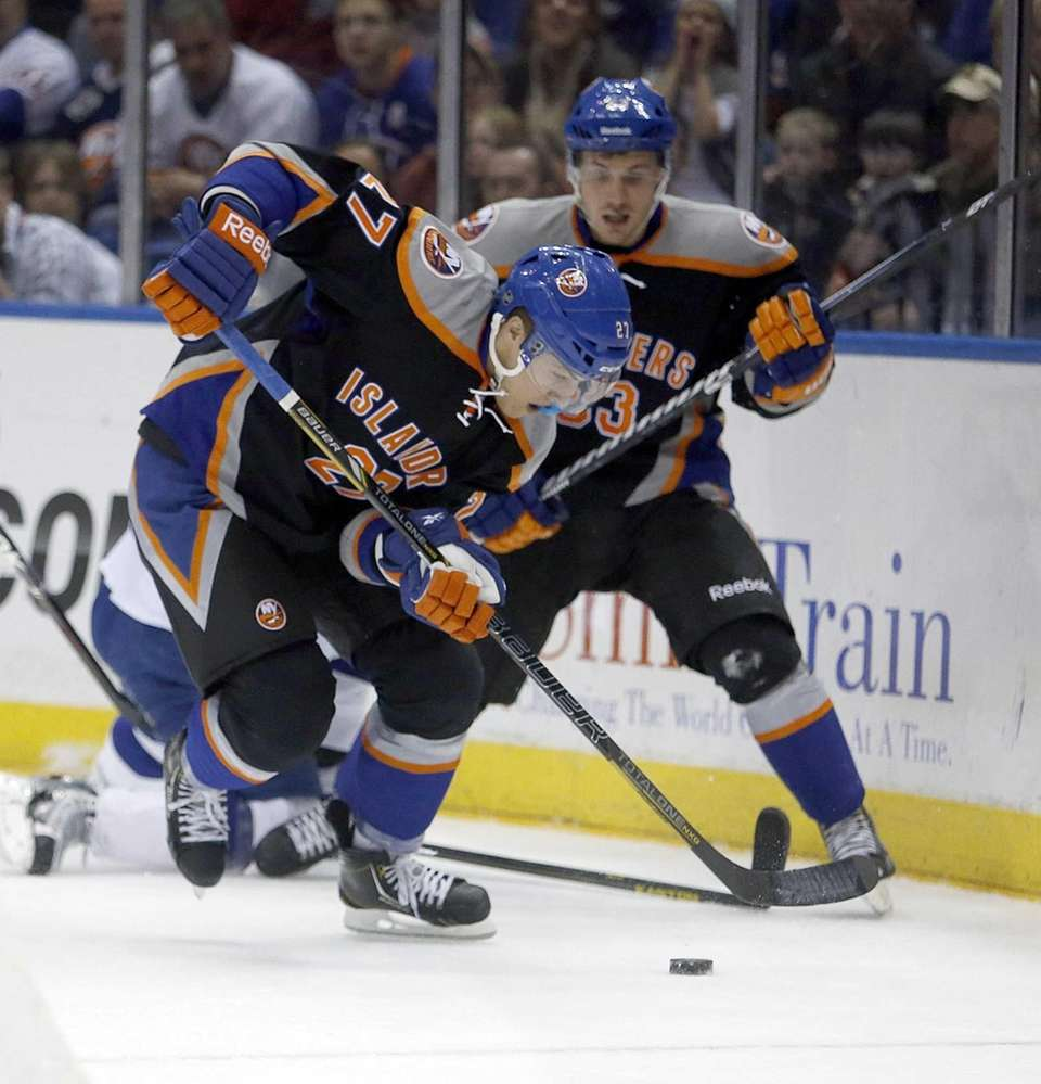 Islanders center Anders Lee (27) comes away with