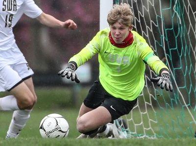 Shoreham-Wading River goalkeeper William Devall dives to makes