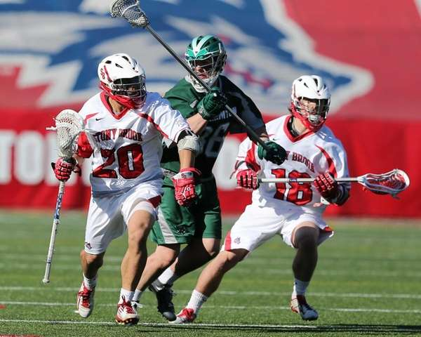 Stony Brook's Jeff Tundo #20 drives past Binghamton