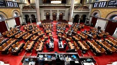 Members of the New York Assembly debate legislation