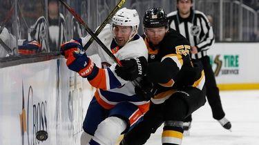 Islanders' Jordan Eberle tries to get past Boston
