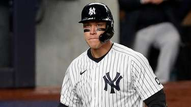 Aaron Judge #99 of the Yankees reacts after