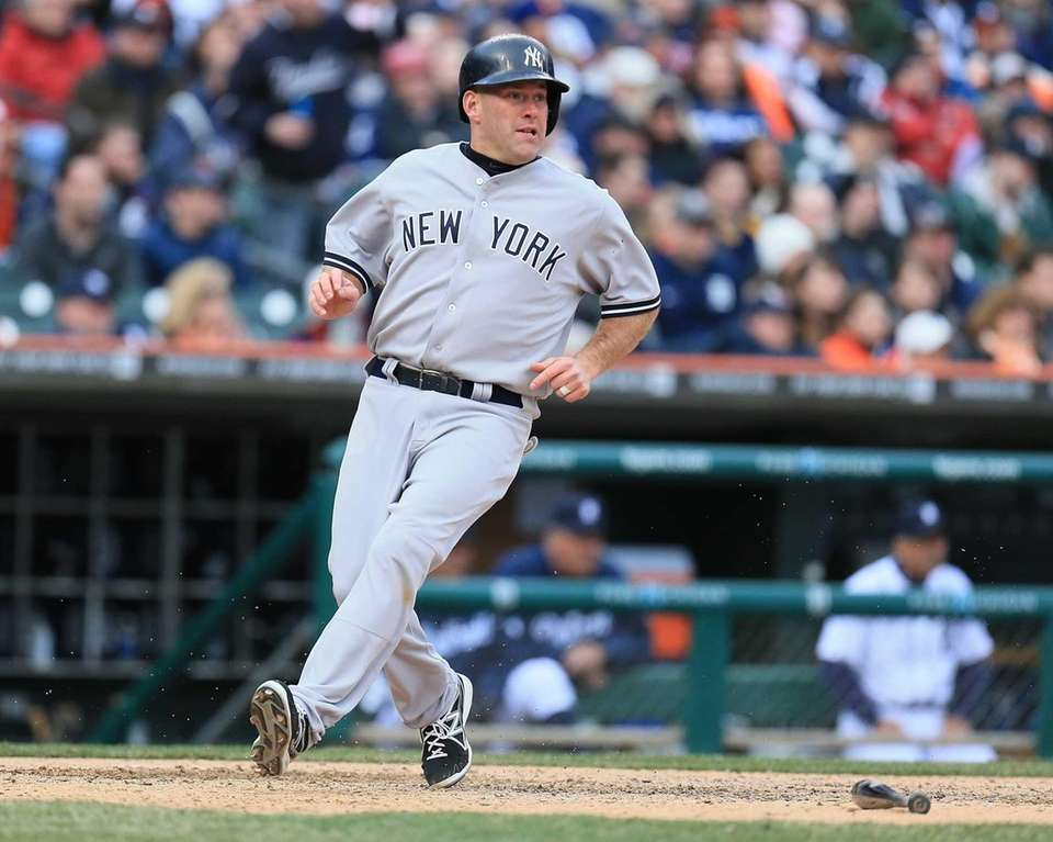 Kevin Youkilis of the Yankees scores a run