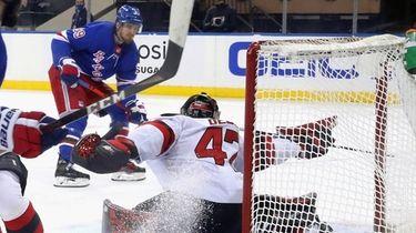 New York Rangers' Pavel Buchnevich, rear, scores against