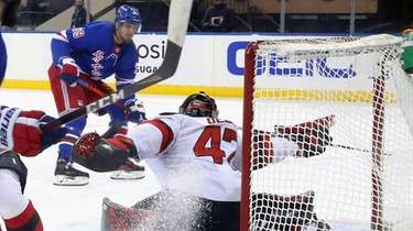 New York Rangers' Pavel Buchnevich, rear, scores against