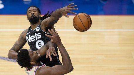 DeAndre Jordan #6 of the Nets guards Joel
