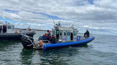 Suffolk County police Marine Bureau officers helped rescue
