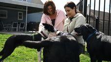Dog owner Christine Gould Murphy, left, of West