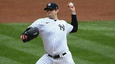 Yankees starting pitcher Jordan Montgomery delivers against the