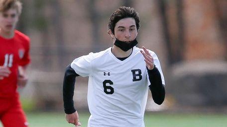 Babylon's Michael Gimeli (6) moves the ball in