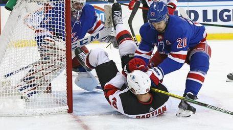 Rangers' Chris Kreider (20) hits New Jersey Devils'