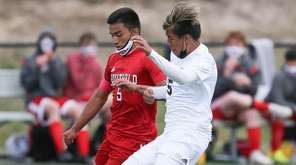 Southold's Daniel Palencia (5) looks to get around