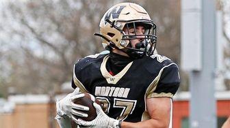 Tyler Martini #27 of Wantagh runs the ball