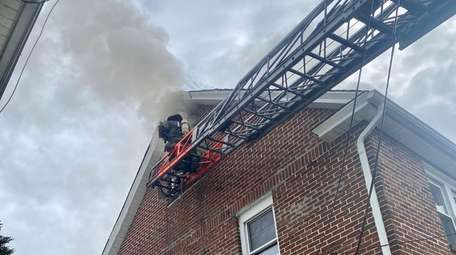 Firefighters at the scene of a fire on