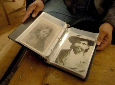 A family album shows Warren Cuffee, right, who