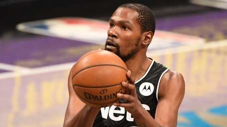 Nets forward Kevin Durant shoots a free throw