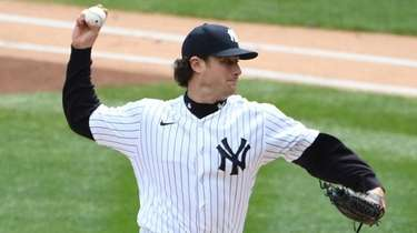 Yankees starting pitcher Gerrit Cole delivers against the