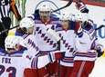 Mika Zibanejad of the Rangers, right, celebrates his