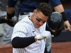 Yankees rightfielder Aaron Judge tosses his helmet after