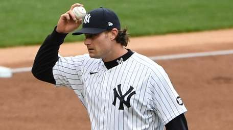 Yankees starting pitcher Gerrit Cole reacts after Rays