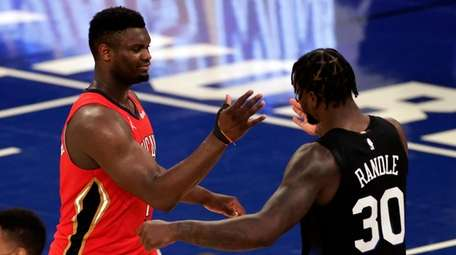 Pelicans forward Zion Williamson, left, shakes hands with