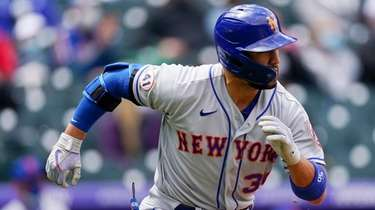 The Mets' Michael Conforto runs up the first-base