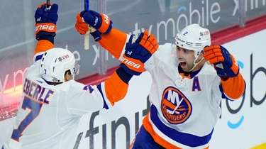 The Islanders' Nick Leddy, right, and Jordan Eberle