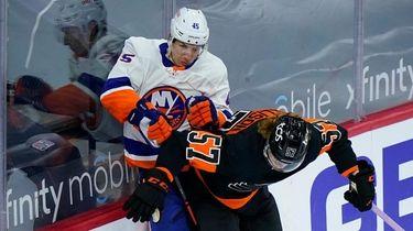 The Flyers' Wade Allison and Islanders' Braydon Coburn
