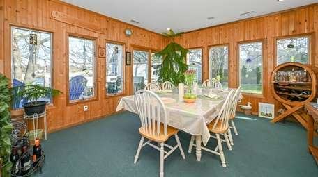 The house has a wood-paneled dining room.